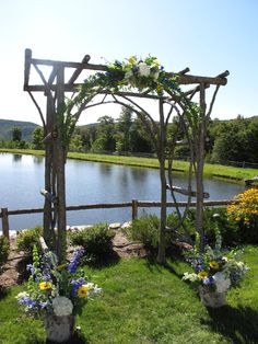 Arbor for wedding ceremony Then add willow twigs and flowers if you want and this location is perfect