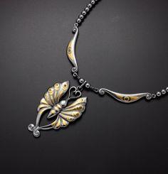 Japanese traditional design butterfly is made of sterling silver.  The fine gold and copper foil are fixed with Keum Boo one by one.  The sterling silver and copper are patinaed by los.  The beads are hematite.