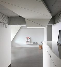 House Wing is a minimalist home located in Seoul, Korea, designed by AnLstudio + Heebon. The space is renovated for a client who is an artist. The actually building is 45 years old, and the residence is on the 10th floor of this apartment complex. The architects wanted to create two clusters without interrupting the overall flow of the space. (4)