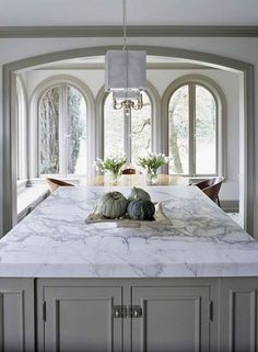 Marble Island Countertop              This kitchen island commands attention. Measuring a substantial 4x8 feet, it is topped with 3-inch-thick Calcutta marble. The classic blue-gray veining of this marble complements the kitchen's elegant, traditional style.