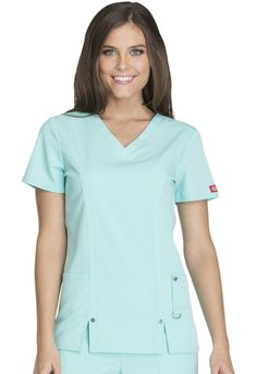 """A Contemporary fit V-neck top features decorative logo eyelets at front princess strapping just above the vents, front patch pockets and a cell phone pocket that includes a self tab with a utility D-ring completed with a logo eyelet. Back princess seams add shape. Center back length: 26"""" Sizes: XS - 3XL Color: Aruba Blue (ABUZ) Brand: Dickies"""