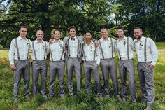 To match the groom in his gray suit, groomsmen wore gray pants, white button downs, and suspenders. | Photo: Maxwell Monty Photography, Groom and Groomsmen's Attire: Hugo Boss
