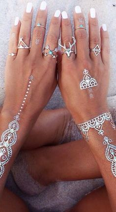 Silver fake tattoos and rings