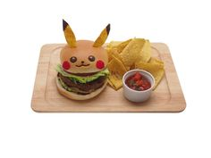 Pikachu Cafe in Japan Serves Pokémon Food. There is currently a limited-time official Pikachu Cafe in Tokyo! It serves Pikachu themed dishes including Pikachu burgers, rice, curry, parfait, fancy desserts and more! Pikachu Pikachu, Pokemon Birthday, Pokemon Party, Pokemon Go, Kreative Desserts, Burgers And More, Food Themes, Food Ideas, Food Humor