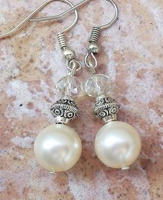 Hey, I found this really awesome Etsy listing at https://www.etsy.com/listing/194566807/swarovski-pearl-unique-earrings-beaded