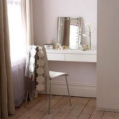 So great! A little corner all set up as a vanity. Love this!