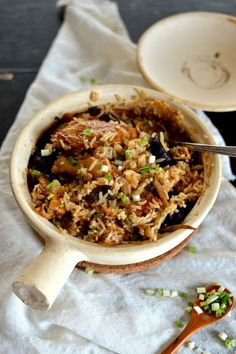 Chicken and Mushroom Clay pot rice is a picture perfect Chinese home-cooked comfort food dish. It has an incredible earthy flavor, courtesy of the classic combination of Chinese black mushrooms, wood ears and lily flowers and the silkiest chicken you ever tasted.