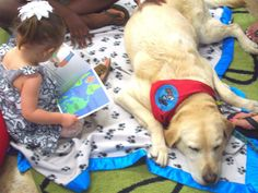 Stacey, Josh and Paige's daughter, reads to Atlas in Return to Joy