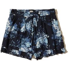 Hollister Ruffle Hem Woven Shorts ($25) ❤ liked on Polyvore featuring shorts, navy floral, navy shorts, hollister co. shorts, floral printed shorts, rayon shorts and beach shorts