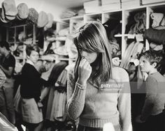French singer and actress Francoise Hardy having a look about some dresses in a dress shop.1960s