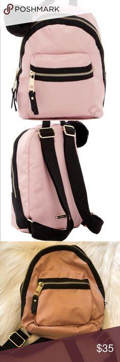 💜STEVE MADDEN PINK NWOT New Mini Bag BackPack! 💜 STEVE MADDEN Stylish print PINK NWOT Mini backpack. Madden girl bold faux fur Pom Pom mini nylon Backpack. Steve Madden Bags Mini Bags
