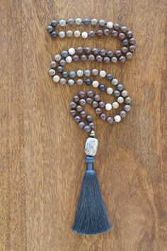 Hand knotted mala beads made with beautiful gray labradorite, purple/red agate…