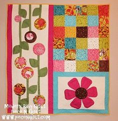 The Modern Baby #Quilt is one of our coolest nontraditional quilt #patterns for baby girls! The 3 sections of this unique baby quilt are pieced separately for simple construction, and each portion shows off bright #patchwork and #applique differently.
