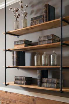 Industrial shelving Fixer Upper: A Craftsman Remodel for Coffeehouse Owners Industrial Shelving, Rustic Shelves, Pipe Shelving, Urban Industrial, Industrial Living, Shelving Ideas, Industrial Furniture, Industrial Pipe, Rustic Cabinets