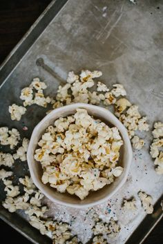 Cake Batter Popcorn - 1/4 cup white chocolate chips - 1 1/2 tsp. coconut oil - 2 tbsp. Cake Batter IdealLean Protein - 4 cups plain, air-popped popcorn - 1 tsp. rainbow sprinkles Directions 1. Line a cookie sheet with parchment paper. Pop your popcorn and lay it flat on the parchment paper so it's ready to be drizzled.  2. Melt the chocolate chips and coconut oil in a microwavable bowl for about 1 minute. If it needs longer, melt in 10 second increments. Once the chocolate is melted,...