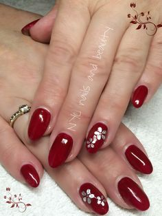 Sculpted acrylics with gel polish and silver flowers