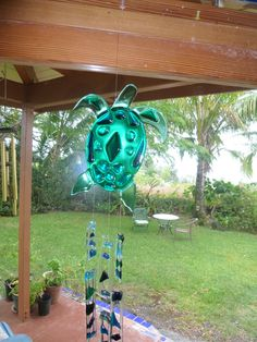 Fused glass green turtle wind chimes.