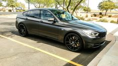 BMW 550i GT wrapped in  avery satin nero