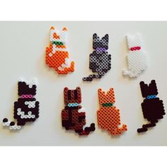 Cats perler beads by lexiscraftstuff