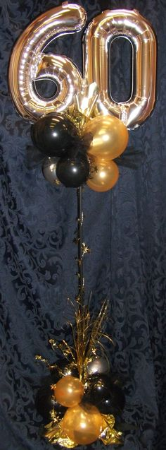 Designed by Balloons by Night Moods in Juneau, Alaska  www.juneausbestballoons.com   Birthday Balloon Centerpiece.