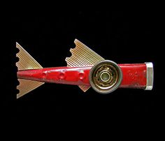 """Red Hummer Kazoo Fish by Lisa and Scott Cylinder  """"Brooch in vintage steel kazoo, 18k bi-metal, sterling silver, epoxy resin, and paint. 2.25 x 5 x 1"""" Item is available Available ($968.00)"""""""