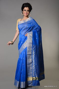 Be bedazzled by the delicately woven zari triangles throughout the saree in shimmering blue on Devpriyantha Flying Triangles Vibrant Blue Chanderi Silk Cotton Saree. Imbibed from the ideas of Chanderi Sarees, this sari is priceless and meant for making you look gorgeous in all ways. Buy this now to look amazingly beautiful.