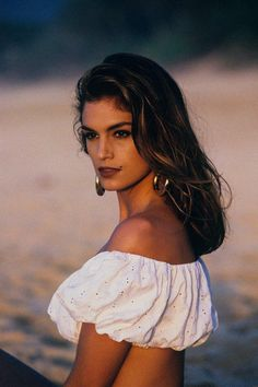 Cindy Crawford in hoops and an off-the-shoulder eyelet top Be featured in Model Citizen App, Magazine and Blog. www.modelcitizenapp.com