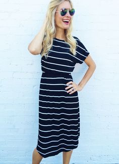 """Model wearing small. Made from 95% rayon, 5% spandex. True to size fit. Elastic at waistband, midi length. Has pockets. Super comfy! 42-46"""" bust, 45-46"""" long"""