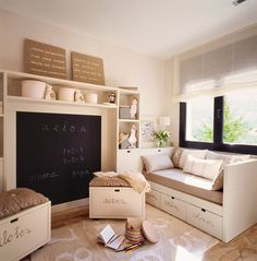 beautiful play space - love the daybed with the storage and the benches with the pillows and the chalkboard in place of a TV!! That's awesome!!