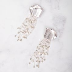 These unusual yet striking earrings will turn heads as you walk by. Lightweight with stainless steel posts, they are perfect for a night out or to shine at the office Colour: Rhodium and silver Beaded Earrings, Statement Earrings, Walking By, Night Out, Santa, Color, Style, Fashion, Swag
