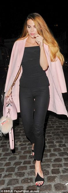 Glamorous: Acid-tongued Made In Chelsea star Victoria Baker-Harber rocked a bright pink coat and handbag