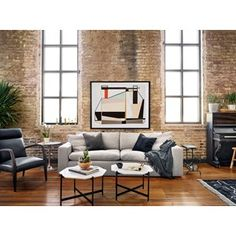 From Left to Right: Abbott Bryson Chair, Marlow Tulip Side Table, Kensington Plume Sofa, Marlow Adair Bunching Table, Loft Full Moon. Loft Industrial, Industrial Apartment, Decoration Inspiration, Room Inspiration, Furniture Inspiration, Scandinavian Interior Design, Gray Sofa, Occasional Chairs, Simple House