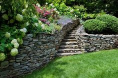 Stone wall and stone steps - path leading to lawn