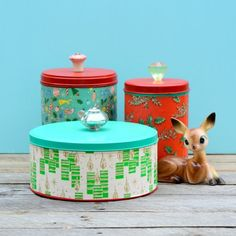 Upcycle some thrift store tins with a little vintage wrapping paper and cabinet knobs.