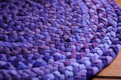 """""""More Purpleness"""" by songofjoy7 (Carol), via Flickr. Another t-shirt rag rug, braided with four-inch wide strips. Beautiful! I would bet that it is sewn together through the braid loops, rather than zig-zag stitched on one side. That (at least) doubles the life of the rug, because you can use both sides. It also works with the nature of the fabric. Stick with similar t-shirt weights."""