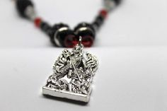 Celebrate Women's Day with this Silver Durga necklace with red & black Kashmiri beads http://etsy.me/2tqRsKD #jewellery #necklace #black #red #bead Goddess Durga is the Indian Goddess of power. She is the epitome of devotion, motherliness, women empowerment.