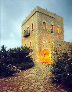 traditional (house-castle) in Mani, Greece continuation of material from floor to wall