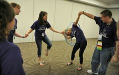 Students race to pass a hula hoop around each other while holding hands as they play cooperative games while participating in the Building Leaders And Strong Tomorrows Youth Group Games, Team Games, Youth Activities, Family Games, Activity Games, Fun Games, Games For Kids, Youth Groups, Board Games