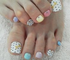 white and colorful polka dot pedicure nail art design with bow details