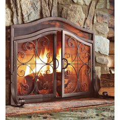 Large crest fireplace screen with doors and tool set this one also ornamental scrollwork in solid wrought iron sets our exclusive crest fireplace screen with doors apart teraionfo