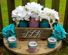 PAINTED JAR CENTERPIECE, Beautiful Rustic Centerpiece 12 small tea light Mason Jars hand painted in turquoise and lilac chalk paint. by TheSouthernBlend on Etsy https://www.etsy.com/listing/244462715/painted-jar-centerpiece-beautiful-rustic