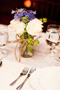 Simple wedding decor - white flowers with blue in mason jar. Photo by Rachel Moore in Downtown Nashville at Cellar One