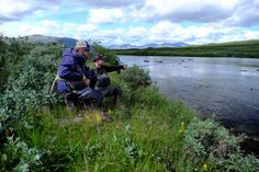 showing Sebastian the spot... he did everything right and hooked a nice grayling! photo by Axel Wessolowski #flyfishing #lapland #mountainriver #arcticgrayling #northflyfishing