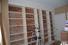 love the brick wall behind the built in shelves. Ikea Hack: Billy Built-in Bookshelves (Part - Home Stories A to Z Ikea Billy Bookcase Hack, Bookshelves Built In, Built Ins, Book Shelves, Bookcases, Billy Regal, Ikea Built In, Faux Brick Walls, Bookcase Styling