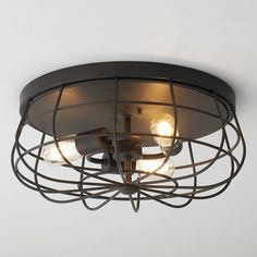 Industrial Cage Ceiling Light Reminiscent of the old wire caged bathroom fans, this ceiling light takes a modern spin on a vintage element. The sleek industrial shape along with exposed bulbs add a trendy style to low ceilings, children's room and retail spaces
