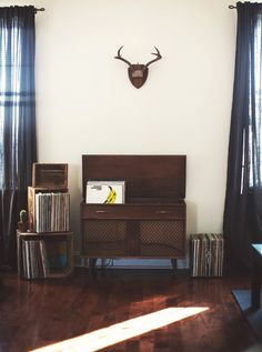 Turn table and speakers built into credenza-like piece. Velvet Underground