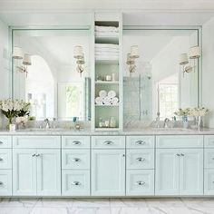 Love the idea of the pale blue cabinets in the bathroom instead of painting the walls. Keep the walls white for natural lighting.