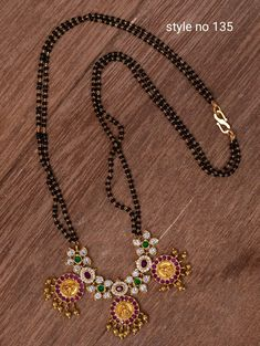 Beautiful one gram gold black bead chain with Lakshmi devi kasu hangings. Black bead chain studded with multi color CZs. Pearl Necklace Designs, Jewelry Design Earrings, Gold Jewellery Design, Bead Jewellery, Beaded Jewelry, Jewelery, Emerald Jewelry, Gold Jewelry Simple, Stylish Jewelry