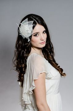 Really, Really Cute!                 https://www.etsy.com/listing/118804848/aegean-fascinator-wedding-fascinator