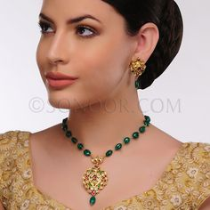 PEN/1/3430 Aamini Pendant Set with Earrings in dull gold finish studded with kundan, rhodonite, and jade stones	 $198 £117
